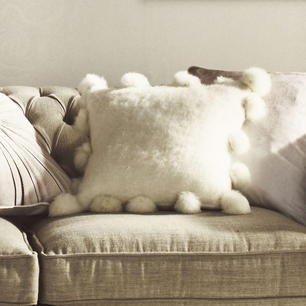 white-pompom-cushion
