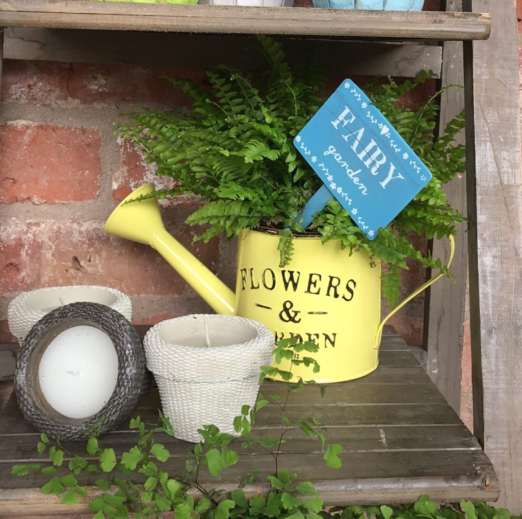 yellow-watering-can-planter