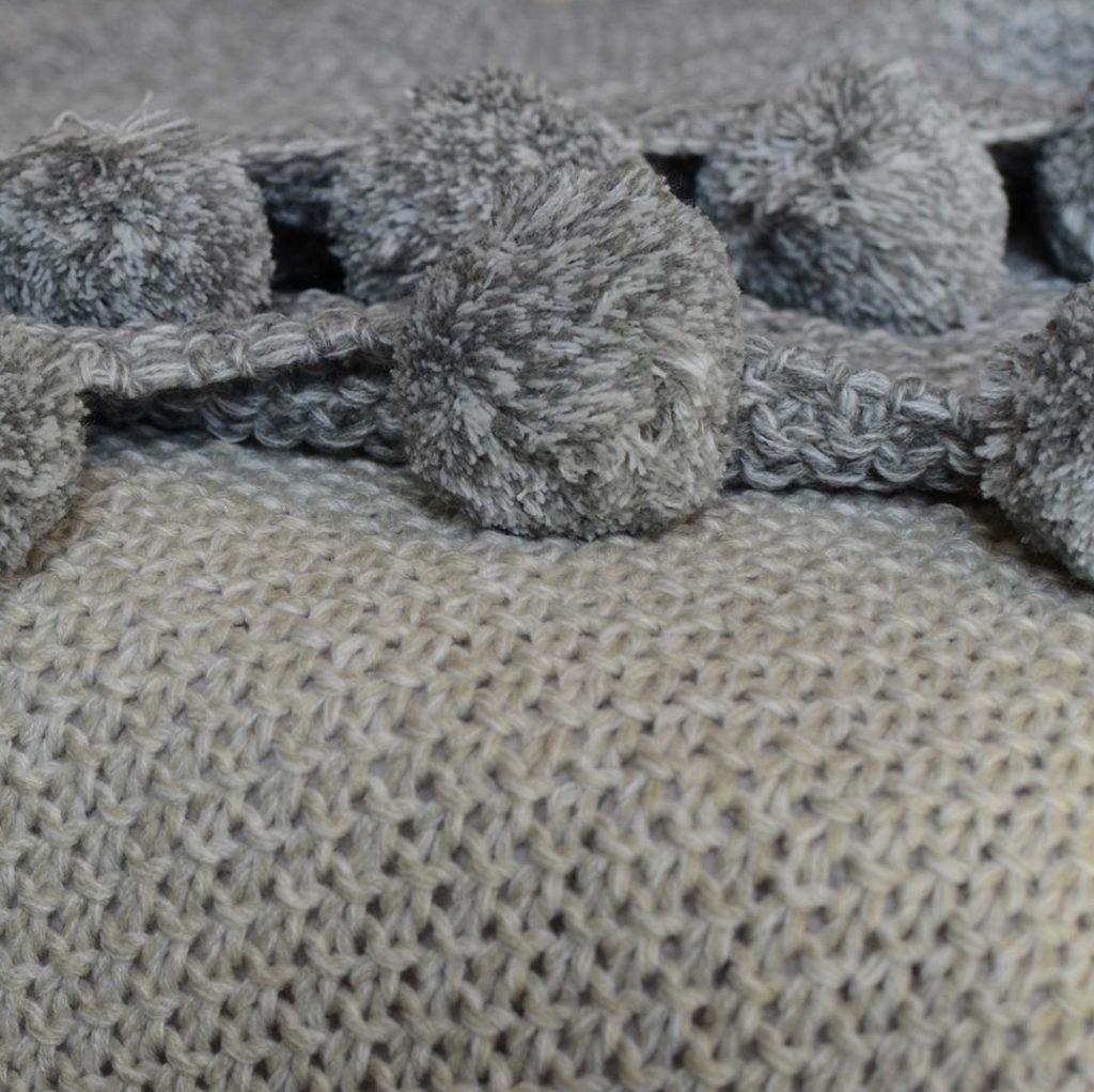 cosy-walton-Pom-Pom-knitted-throw